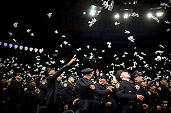 Thu Dec 22, 2011:  NYPD Police Academy Graduation at Madison Square Garden..Credit: Rob Bennett for The Wall Street Journal