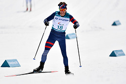 DAVIET Benjamin FRA LW2 competing in the ParaSkiDeFond, Para Nordic Skiing, 20km at  the PyeongChang2018 Winter Paralympic Games, South Korea.