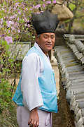 Korean Folk Village. Man with traditional clothes and horse hair hat.