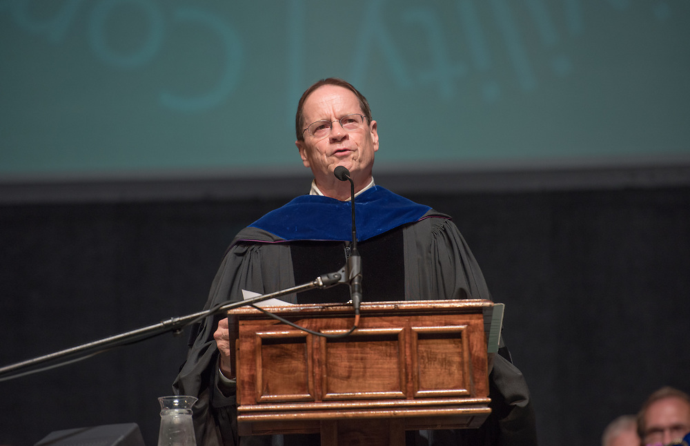 David Descutner, Interim Executive Vice President and Provost, speaks at the President's Convocation for First-Year Students at the Convocation Center. Photo by Ben Siegel