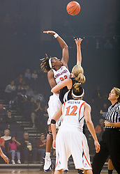 Virginia center Aisha Mohammed (33) leaps for the opening tip.  The #15 ranked Virginia Cavaliers defeated the High Point Panthers 78-48 in NCAA Women's Division 1 Basketball at the John Paul Jones Arena on the Grounds of the University of Virginia in Charlottesville, VA on November 14, 2008.