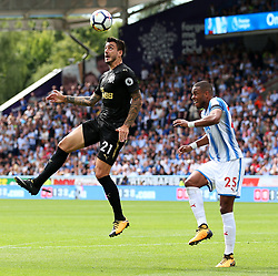 Newcastle United's Joselu wins a header above Huddersfield Town's Mathias Zanka Jorgensen - Mandatory by-line: Matt McNulty/JMP - 20/08/2017 - FOOTBALL - John Smith's Stadium - Huddesfield, England - Huddersfield Town v Newcastle United - Premier League