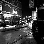 """Wicker Park neighborhood in Chicago, Illinois, USA at Damen & Division intersections and Blue Line """"El"""" train stop."""