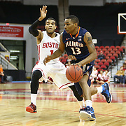 Tracy Abrams #13 of the Illinois Fighting Illini dribbles past Maurice Watson Jr. #1 of the Boston University Terriers during the NIT First Round game at Agganis Arena on March 19, 2014 in Boston, Massachusetts . (Photo by Elan Kawesch)