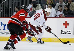 Mar 12, 2009; Newark, NJ, USA; Phoenix Coyotes right wing Shane Doan (19) skates with the puck while being defended by New Jersey Devils defenseman Paul Martin (7) during the first period at the Prudential Center.