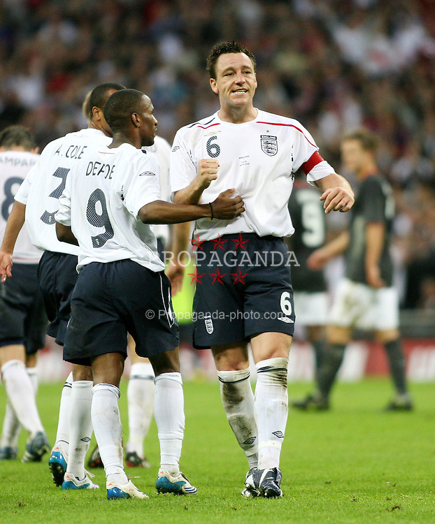 London, England - Wednesday, May 28, 2008: England's John Terry celebrates scoring the opening goal against USA at Wembley Stadium. (Pic by Chris Ratcliffe/Propaganda)