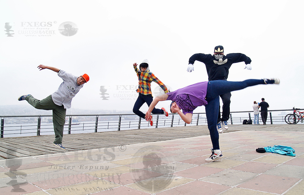 Four breakdancers jumping at the same time