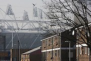 East London housing and the 2012 Olympic stadium that dominates the end of a street of a nearby estate.