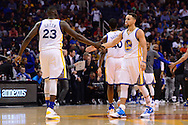 Feb 10, 2016; Phoenix, AZ, USA; Golden State Warriors guard Stephen Curry (30) congratulates forward Draymond Green (23) during the game against the Phoenix Suns at Talking Stick Resort Arena. The Golden State Warriors won 112-104. Mandatory Credit: Jennifer Stewart-USA TODAY Sports