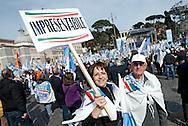 2013/03/23 Roma, manifestazione del PDL Popolo della Liberta'. Nella foto alcuni manifestanti.<br /> Rome, Popolo della Liberta' (reading The Peolple of Freedom Party) demo. In the picture some supporters hold a note reading ' unpresentable ' - &copy; PIERPAOLO SCAVUZZO