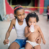 Young residents of Largo do Tanque watch a demolition of homes in their favela, in Rio de Janeiro's West Zone, to make room for the Transcarioca Highway, that will eventually be built to accommodate the Olympics, in Rio de Janeiro, Brazil, on Monday, Feb. 25, 2013. <br />