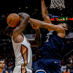 Nov 1, 2017; New Orleans, LA, USA; Minnesota Timberwolves center Karl-Anthony Towns (32) blocks New Orleans Pelicans center DeMarcus Cousins (0) during the second half of a game at the Smoothie King Center. The Timberwolves defeated the Pelicans 104-98. Mandatory Credit: Derick E. Hingle-USA TODAY Sports