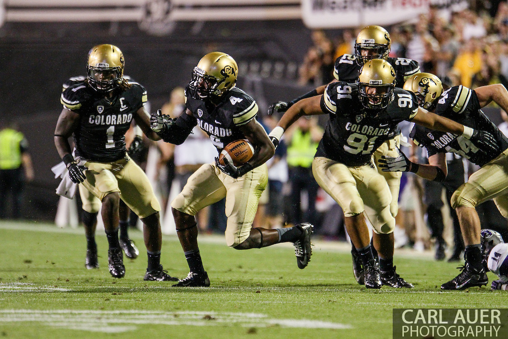 September 7th, 2013 - Colorado Buffaloes freshman defensive back Chidobe Awuzie (4) runs with the ball that he stripped from a Bears wide receiver in the fourth quarter of the NCAA football game between the University of Central Arkansas Bears and the University of Colorado Buffaloes at Folsom Field in Boulder, CO