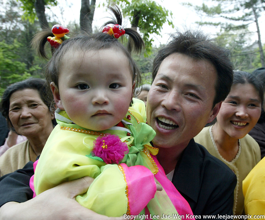 A North Korean family in Pyongyang enjoy May Day, one of the most celebrated holidays in the North. Photo by Lee Jae-Won (NORTH KOREA) www.leejaewonpix.com/