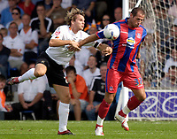 Photo: Daniel Hambury.<br />Luton Town v Crystal Palace. Coca Cola Championship. 09/09/2006.<br />Luton's Marcus Heikkinen and Palace's Shefki Kuqi battle.