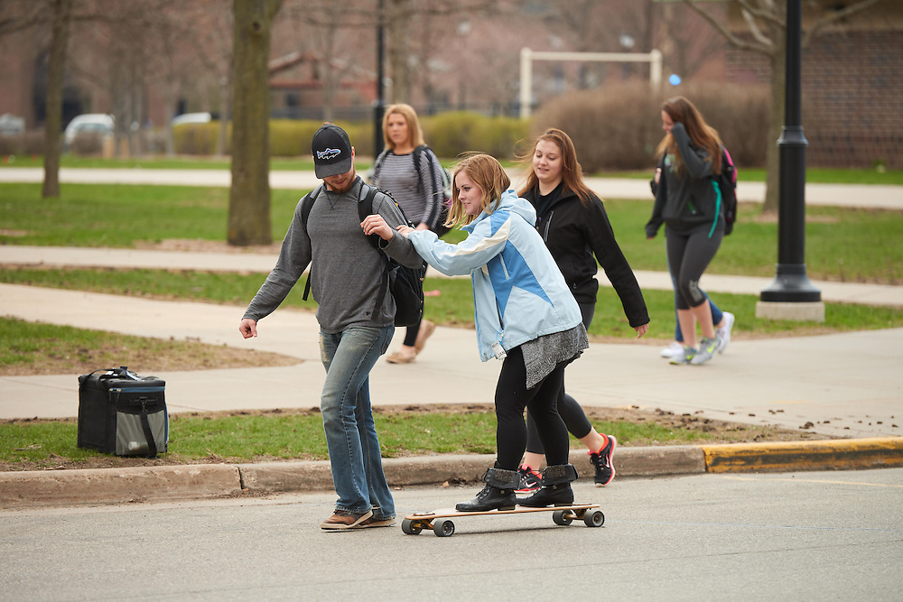 Activity; Socializing; Location; Outside; People; Student Students; Spring; April; Time/Weather; cloudy; Type of Photography; Candid; Buildings; Wimberly; Long board skate