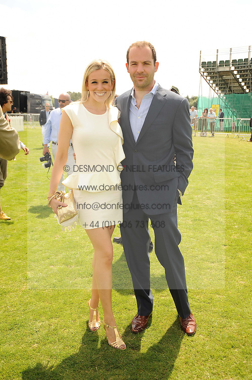MARTIN LEWIS and his wife TV presenter LARA LEWINGTON at the Cartier International Polo at Guards Polo Club, Windsor Great Park, Berkshire on 25th July 2010.