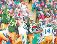 (Published caption 11/10/97) Green Bay's Bernardo Harris (55) leaps just before blocking a field-goal attempt by Rams kicker Jeff Wilkins. Packers defenders Gilbert Brown (93) and Keith McKenzie (95) also apply pressure on the play.