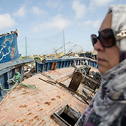 Mounira Chagrani, the mother of Amin Ben Hassine, is searching for Tunisian boats on Lampedusa's boat cemetery. In September 2010, Amin, a young student from Tunisia, 27 years, managed to land on Italian shores after leaving his country on a boat. His mother, Mounira has never heard from him since. Though she has contacted the Italian authorities, they have no response or give any information about his whereabouts. She represents 501 mothers whose children have disappeared during and in the aftermath of the Arab Spring and in transit in Italy