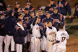 The Virginia Cavaliers Baseball Team congratulate Virginia Cavaliers infielder Jeremy Farrell (17) after a sacrifice to advance a baserunner against Bucknell.  The Virginia Cavaliers Baseball Team defeated the Bucknell University Bison 2-0 at Davenport Field in Charlottesville, VA on February 23, 2007.