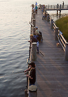 Fishing on the Connecticut River along walkway at Amtrak Bridge, Old Lyme, CT
