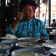 An ethnic minority woman eats breakfast at the Tam Son weekend market in Ha Giang, Vietnam's northernmost province.