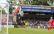 Great save from Adam Bartlett during the Sky Bet League 2 match between York City and Hartlepool United at Bootham Crescent, York, England on 15 August 2015. Photo by Simon Davies.
