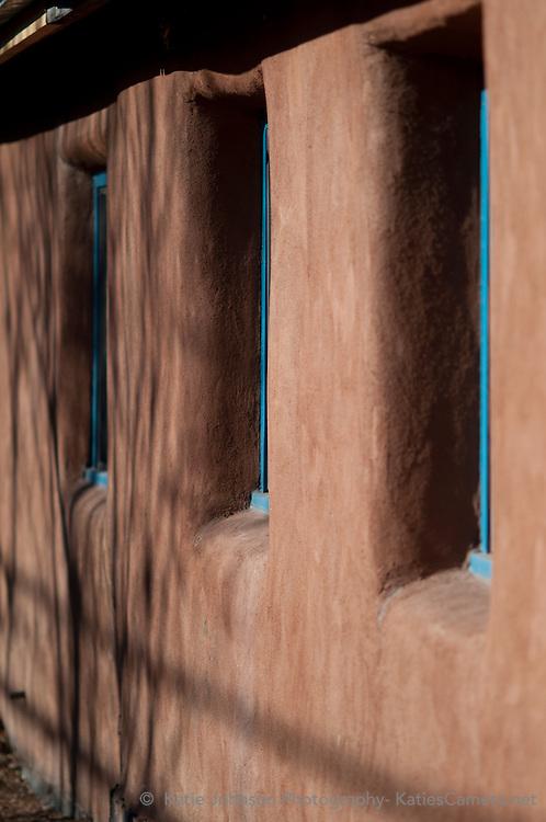 Santa Fe adobe home house pueblo style historic adobe brick blue windows spirit