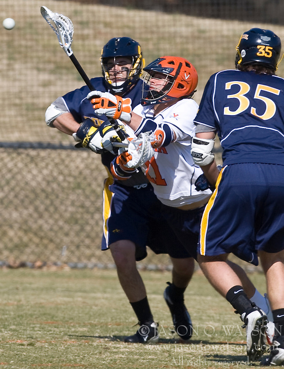 Virginia Cavaliers M George Huguely (11) in action against Drexel.  The #2 ranked Virginia Cavaliers defeated the Drexel Dragons 13-7 at the University of Virginia's Klockner Stadium in Charlottesville, VA on February 14, 2009.