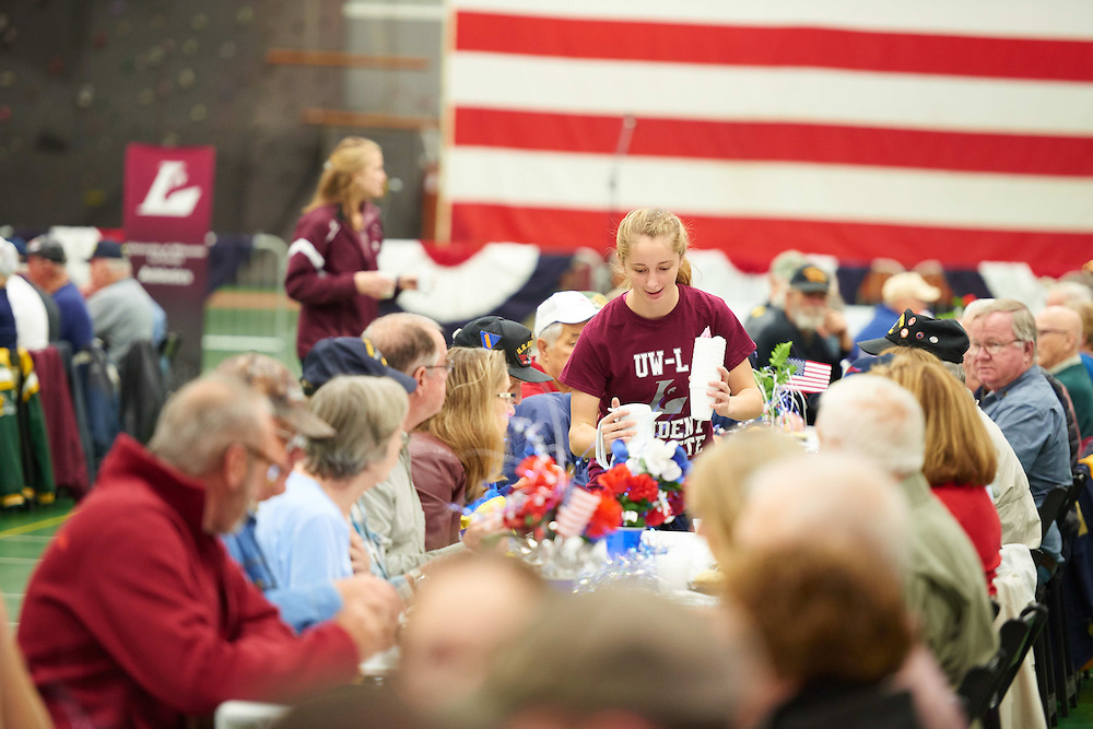 -UWL UW-L UW-La Crosse University of Wisconsin-La Crosse; Athlete Athletics; Candid; day; Daytime; Eating; Fall; Flag; Group; Inside; Mitchell Hall Fieldhouse; November; Socializing; Talking, Veterans, Breakfast, respect, Patriotism