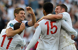 Joleon Lescott (2nd R) of England celebrates for his goal with teammate Steven Gerrard (2nd L) of England during the 1-1 draw in the Group D Match Against France AT The Euro 2012 Football Championships in Donetsk, Ukraine, June 11 2012. Photo By Imago/i-Images