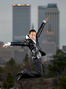 Tulsa Ballet Theater dancer Ma Cong against the downtown skyline in Tulsa, OK.
