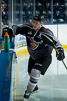 KELOWNA, BC - JANUARY 4: Tristen Nielsen #8 of the Vancouver Giants throws pucks to the ice at the start of warm up against the Kelowna Rockets at Prospera Place on January 4, 2020 in Kelowna, Canada. (Photo by Marissa Baecker/Shoot the Breeze)