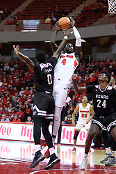 "07 January 2018:  Daouda ""David"" Ndiaye puts up a shot while double teamed by Abdul Fofana and Alize Johnson during a College mens basketball game between the Missouri State Bears and Illinois State Redbirds in Redbird Arena, Normal IL"