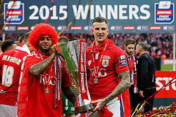 Mark Little and Aden Flint of Bristol City lift the Football League Trophy after thay win the match 2-0 - Photo mandatory by-line: Rogan Thomson/JMP - 07966 386802 - 22/03/2015 - SPORT - FOOTBALL - London, England - Wembley Stadium - Bristol City v Walsall - Johnstone's Paint Trophy Final.