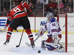 Nov 5, 2010; Newark, NJ, USA;  New Jersey Devils right wing Dainius Zubrus (8) tips the puck wide of New York Rangers goalie Henrik Lundqvist (30) during the first period at the Prudential Center.