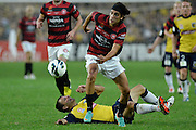 21.04.2013 Sydney, Australia. Wanderers German midfielder Jérome Polenz in action during the Hyundai A League grand final game between Western Sydney Wanderers FC and Central Coast Mariners FC from the Allianz Stadium.Central Coast Mariners won 2-0.