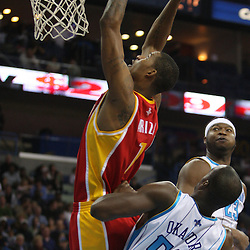 Jan 02, 2010; New Orleans, LA, USA; Houston Rockets forward Trevor Ariza (1) shoots over New Orleans Hornets center Emeka Okafor (50) during a game at the New Orleans Arena. Mandatory Credit: Derick E. Hingle-US PRESSWIRE