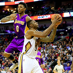 Nov 12, 2016; New Orleans, LA, USA;  Los Angeles Lakers guard Nick Young (0) fouls New Orleans Pelicans forward Terrence Jones (9) during the second half of a game at the Smoothie King Center. The Lakers defeated the Pelicans 126-99. Mandatory Credit: Derick E. Hingle-USA TODAY Sports
