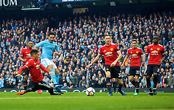 MANCHESTER, ENGLAND - Saturday, April 7, 2018: Manchester City's Ilkay Gundogan scores the second goal during the FA Premier League match between Manchester City FC and Manchester United FC at the City of Manchester Stadium. (Pic by David Rawcliffe/Propaganda)