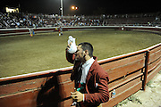 BEA AHBECK CASSON/bahbeck@mercedsunstar.com<br /> Amadores de Merced's Andre Melo ices his nose after he took a hit while grabbing a bull during the bloodless bullfight in Gustine Monday, June 30, 2014.