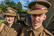 A  woman in a period ATS uniform poses with a serving Life Guard soldier, also wearing vintage costume and  sporting a well groomed moustache in St James Park. VE Day 70 commemorations - Three days of events in London and across the UK marking historic anniversary of end of the Second World War in Europe. Trafalgar Square, scene of jubilant celebrations marking the end of the Second World War in Europe on 8 May 1945, plays a central part in a host of national events, which include a Service of Remembrance at the Cenotaph, a concert in Horse Guards Parade, a Service of Thanksgiving at Westminster Abbey, a parade of Service personnel and veterans and a flypast.