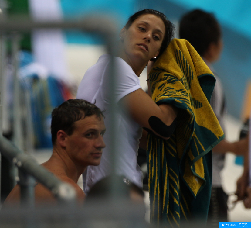USA swimmer Ryan Lochte talking with Australian swimmer Blair Evans during training at the Aquatic Centre at Olympic Park, Stratford during the London 2012 Olympic games preparation at the London Olympics. London, UK. 23rd July 2012. Photo Tim Clayton