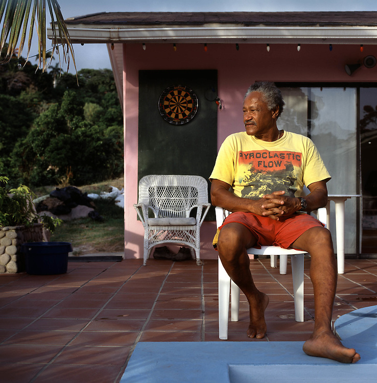 Danny Sweeney, fisherman and former windsurf teacher to rock stars, at his house he bought for a song. The tropical Caribbean island of Montserrat which has suffered badly since the eruption of the Soufriere Hills volcano 10 years ago. Two thirds of the island is out of bounds to everyone except scientists. .