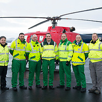 SCAA..Scotland's Charity Air Ambulance have started to train the five paramedics who will man the new Air Ambulance to be based in Perth, pictured from left is pilot Peter Quick, paramedics Alex Holden from Falkirk, Bruce Rumgay from Dundee, Wayne Auton from Tarbet, Andy Walker from Milnathort and John Pritchard from Crieff and Andy Mottram Bond Aviation Services Training Manager. Also pictured is a Bolkow 105 from Bond Aviation Services who have been chosen to provice the aircraft for SCAA and it joined up with the paramedics in a snowy Perth to start the training process....24.01.13<br /> For further info contact Maureen Young on 07778 779888<br /> Picture by Graeme Hart.<br /> Copyright Perthshire Picture Agency<br /> Tel: 01738 623350  Mobile: 07990 594431