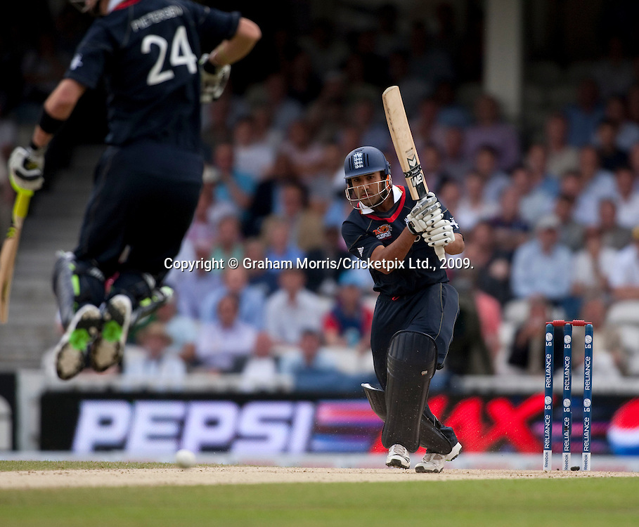 Ravi Bopara drives past the leaping Kevin Pietersen during the ICC World Twenty20 Cup match between West Indies and England at The Oval. Photo © Graham Morris (Tel: +44(0)20 8969 4192 Email: sales@cricketpix.com)