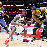 02 December 2015: Los Angeles Clippers forward Lance Stephenson (1) defends on Indiana Pacers forward Paul George (13) next to Indiana Pacers center Jordan Hill (27) during the Indiana Pacers 103-91 victory over the Los Angeles Clippers, at the Staples Center, Los Angeles, California, USA.