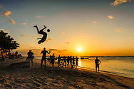 During my trip on Zanzibar, Tanzania, I found this cool sunset jump and kick game on Stonetown beach.  Young locals were jumping one after the other to show their tire jumping skills while trying to kick the soccer ball at the same time.  Great moment!