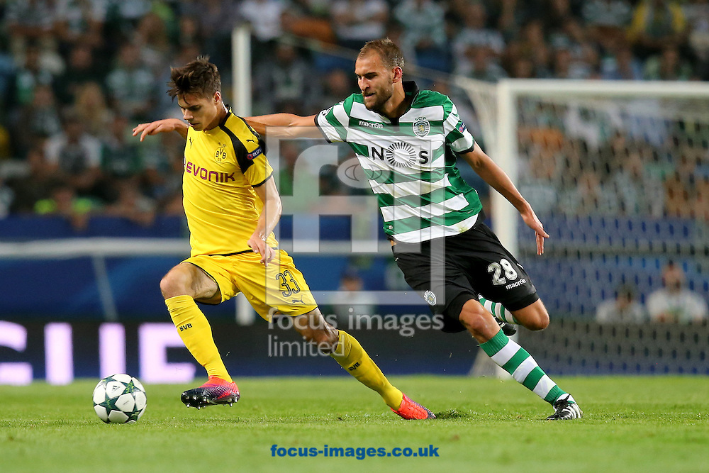 Bas Dost of Sporting Clube de Portugal and Julian Weigl of Borussia Dortmund during the UEFA Champions League match at Est&Atilde;&iexcl;dio Jos&Atilde;&copy; Alvalade, Lisbon<br /> Picture by EXPA Pictures/Focus Images Ltd 07814482222<br /> 18/10/2016<br /> *** UK &amp; IRELAND ONLY ***<br /> EXPA-EIB-161018-0050.jpg