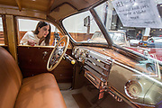 UNITED KINGDOM, London: 24 April 2018 Maria, from Greece, takes a closer look at a 1941 Buick Eight Series Model 49 'Woodie' Wagon. The car forms part of the Spring Classics: An Important Auction of Fine Historic Automobiles at The Royal Horticultural Halls, Westminster. The auction will see a collection of privately owned cars be auctioned this evening April 24th 2018. Rick Findler  / Story Picture Agency